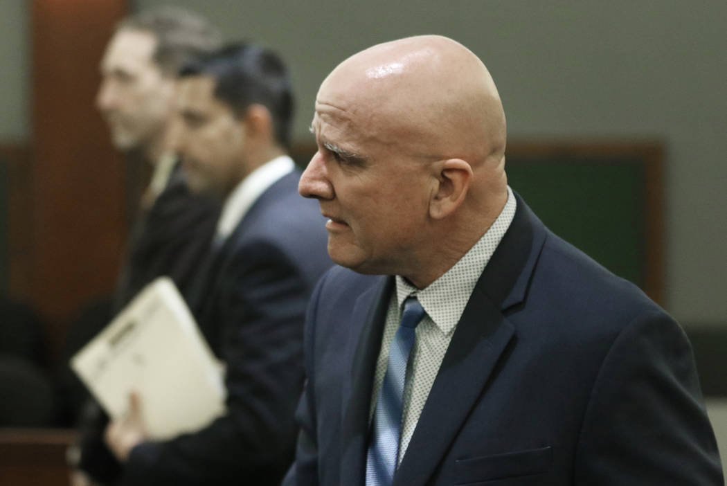 """Las Vegas police Lt. James """"Tom"""" Melton, right, reacts after being found not guilty o ..."""