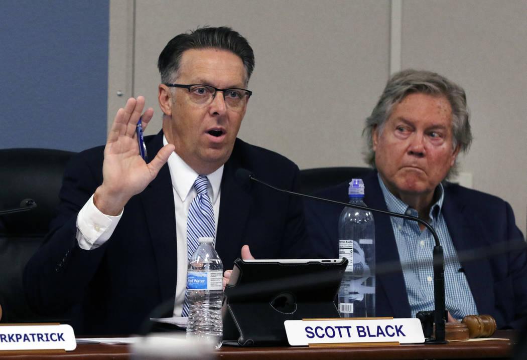 Scott Black, the Southern Nevada Health District chairman, speaks as Board Member, Tick Segerbl ...