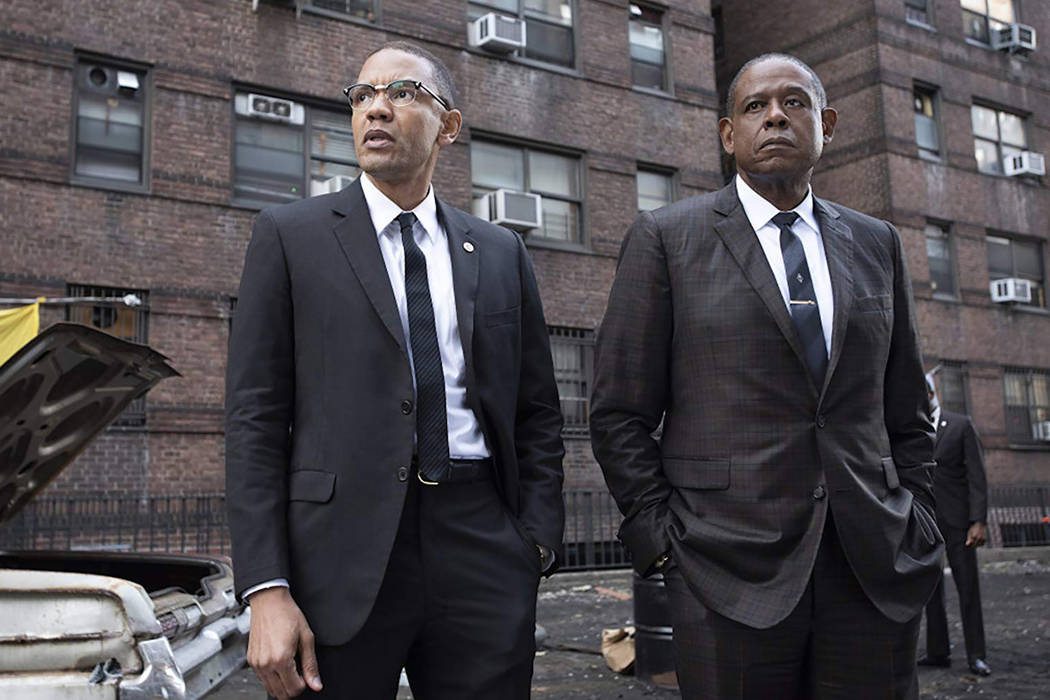 "Malcolm X (Nigel Thatch) and Bumpy Johnson (Forest Whitaker) in a scene from ""Godfather of ..."