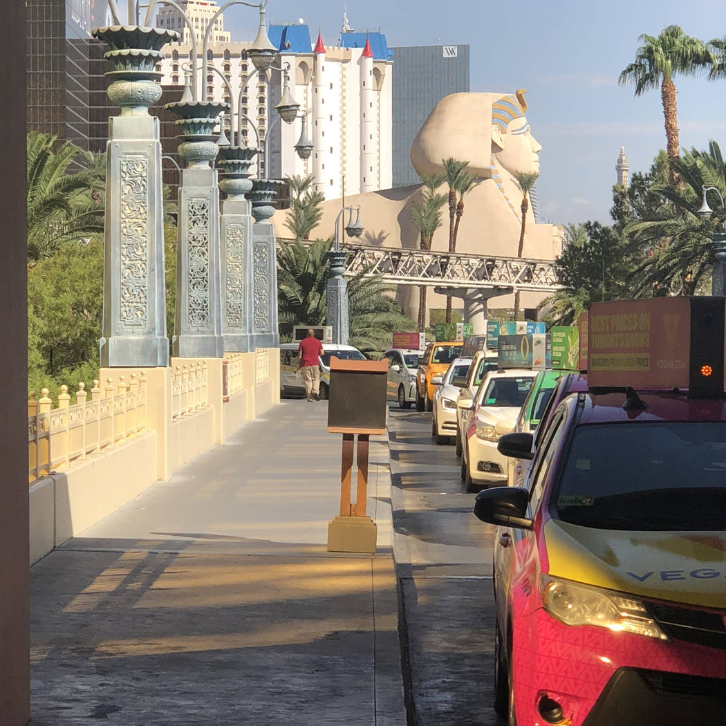Taxis are lined up outside Mandalay Bay on the Las Vegas Strip on Monday, Oct. 1, 2018. Todd Pr ...
