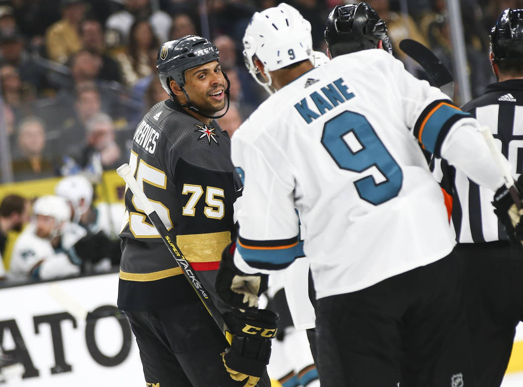 Golden Knights right wing Ryan Reaves (75) exchanges words with San Jose Sharks left wing Evand ...