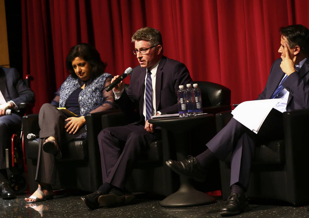 Michael Kagan, professor at UNLV's Boyd School of Law, center, speaks during a panel about Isla ...