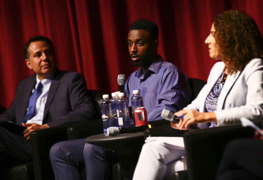UNLV student Mahir Hussein, president of the UNLV Muslim Student Association, center, speaks du ...
