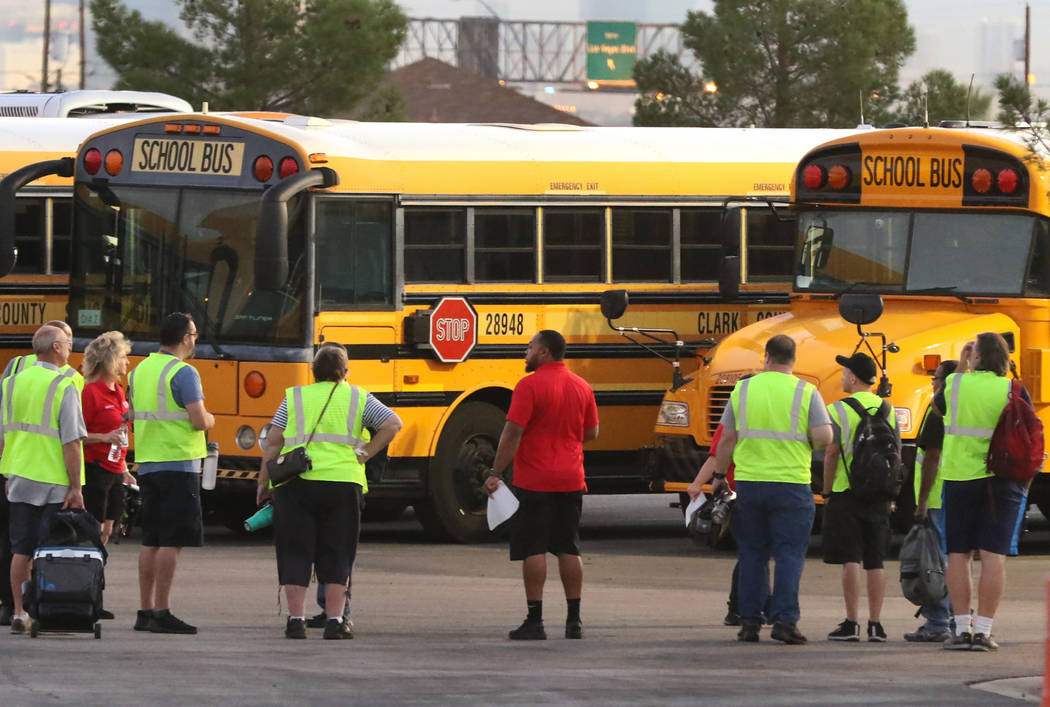In this Aug. 12, 2019, file photo, the Clark County School District's (CCSD) bus drivers arrive ...