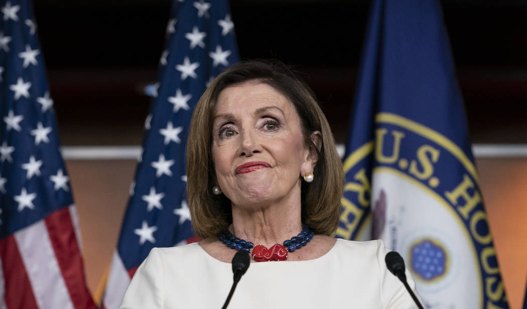 Speaker of the House Nancy Pelosi, D-Calif., addresses reporters at the Capitol in Washington, ...