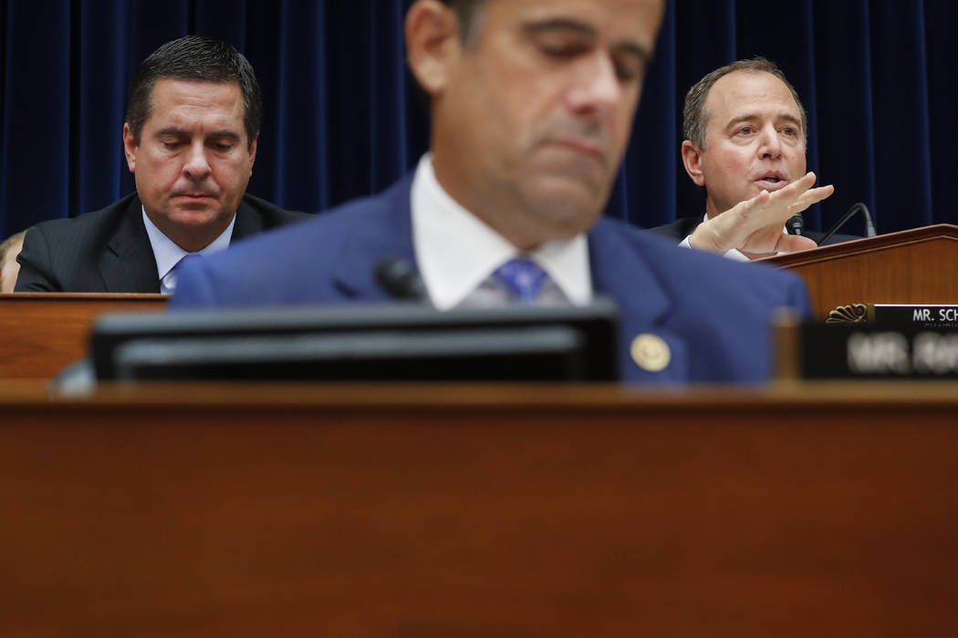 Chairman Rep. Adam Schiff, D-Calif., right, questions Acting Director of National Intelligence ...