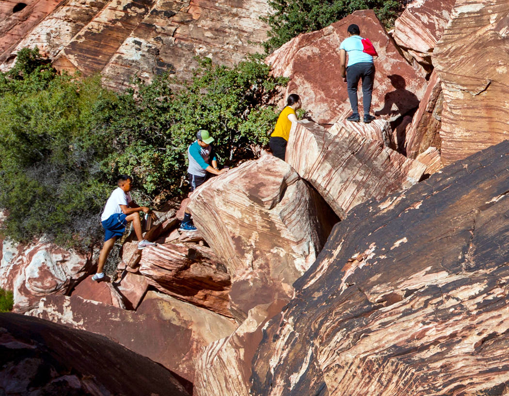 Visitors boulder in the Calico 1 area within the Red Rock Canyon National Conservation Area on ...