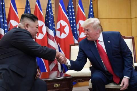 In a June 30, 2019, file photo, U.S. President Donald Trump, right, meets with North Korean lea ...