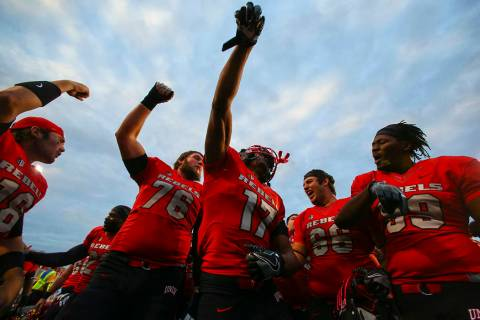 UNLV players celebrate after defeating Wyoming 69-66 in a triple overtime football game at Sam ...