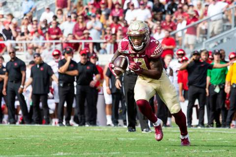 In this Sept. 21, 2019, file photo, Florida State running back Cam Akers (3) heads toward the g ...