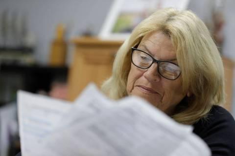 Linda Morris looks over her Medicare statements, Wednesday, Sept. 25, 2019, in Parker City, Ind ...