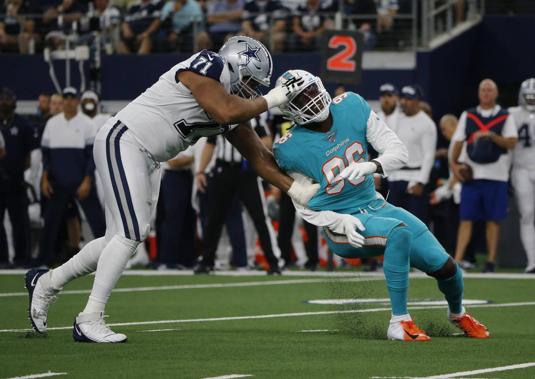 Dallas Cowboys offensive tackle La'el Collins (71) blocks Miami Dolphins defensive end Taco Cha ...