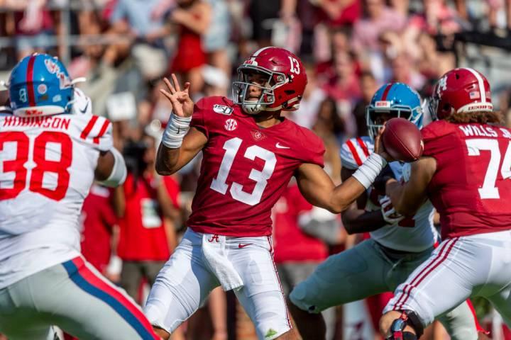 Alabama quarterback Tua Tagovailoa (13) throws long during the first half of an NCAA college fo ...