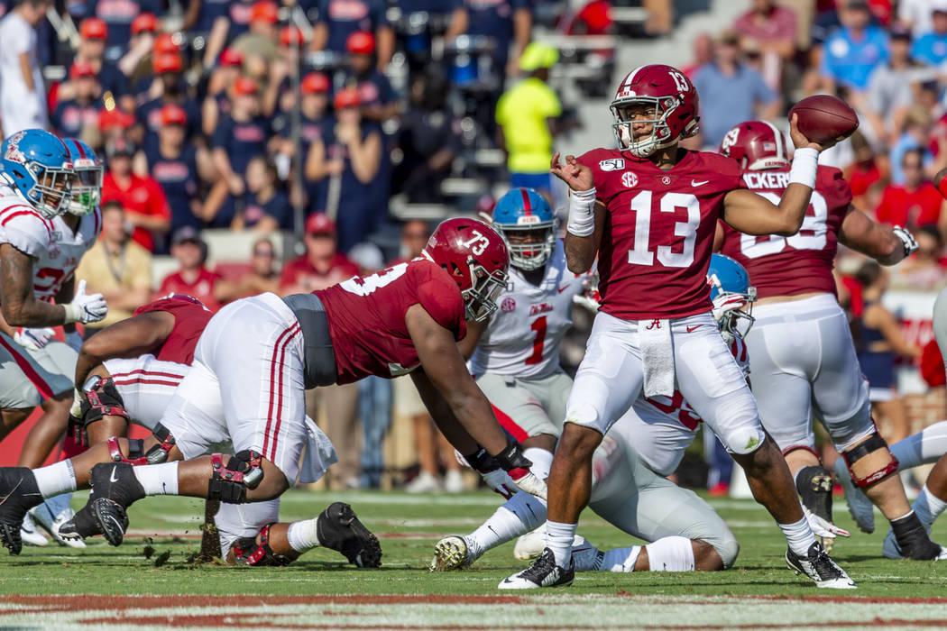 Alabama quarterback Tua Tagovailoa (13) throws to the edge against Mississippi during the first ...
