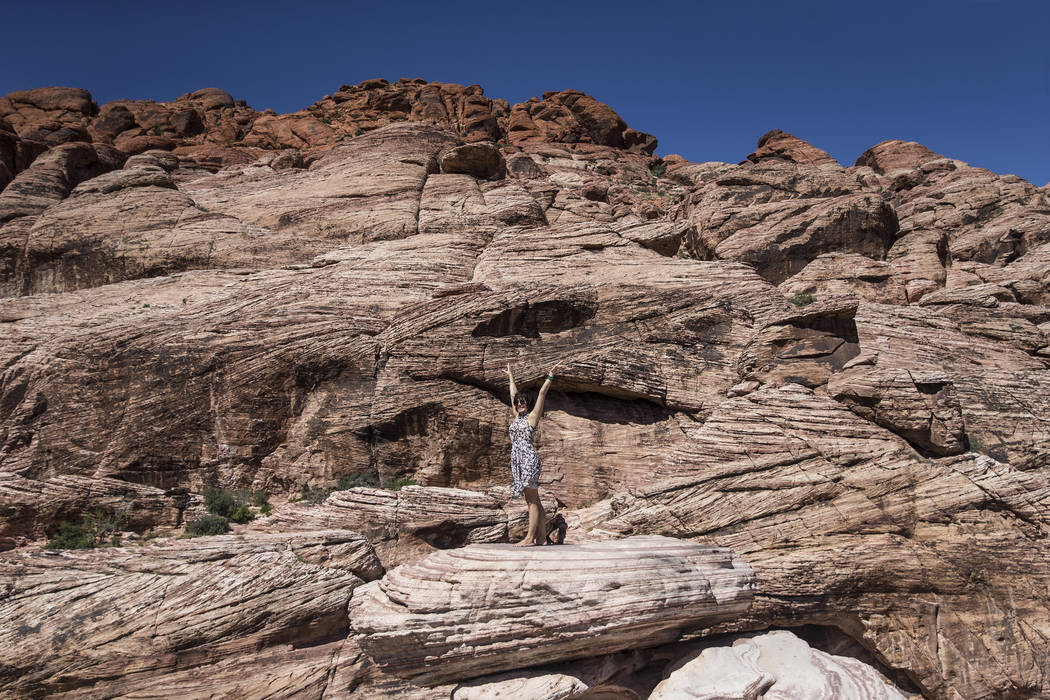"""Oksana Watson climbs a boulder during """"National Get Outdoors Day"""" at Red Rock Canyon National C ..."""