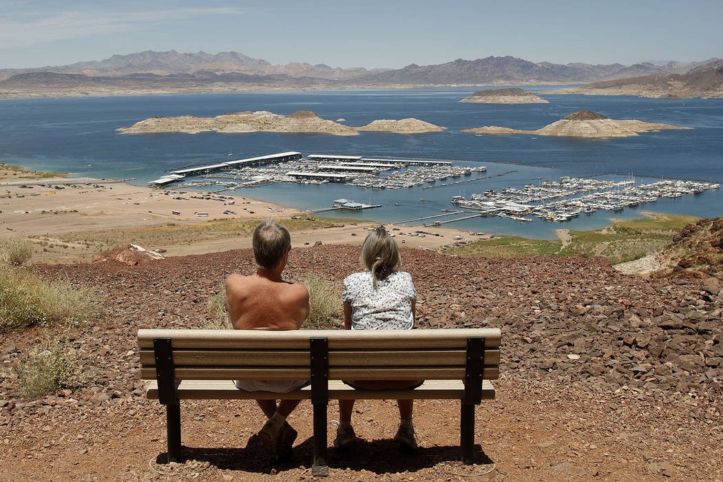 A couple takes a break along the Historic Railroad Trail overlooking Lake Mead. (Las Vegas Revi ...