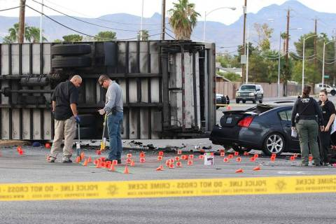 Las Vegas police investigate a fatal crash involving two cars and a box truck at East Tropicana ...