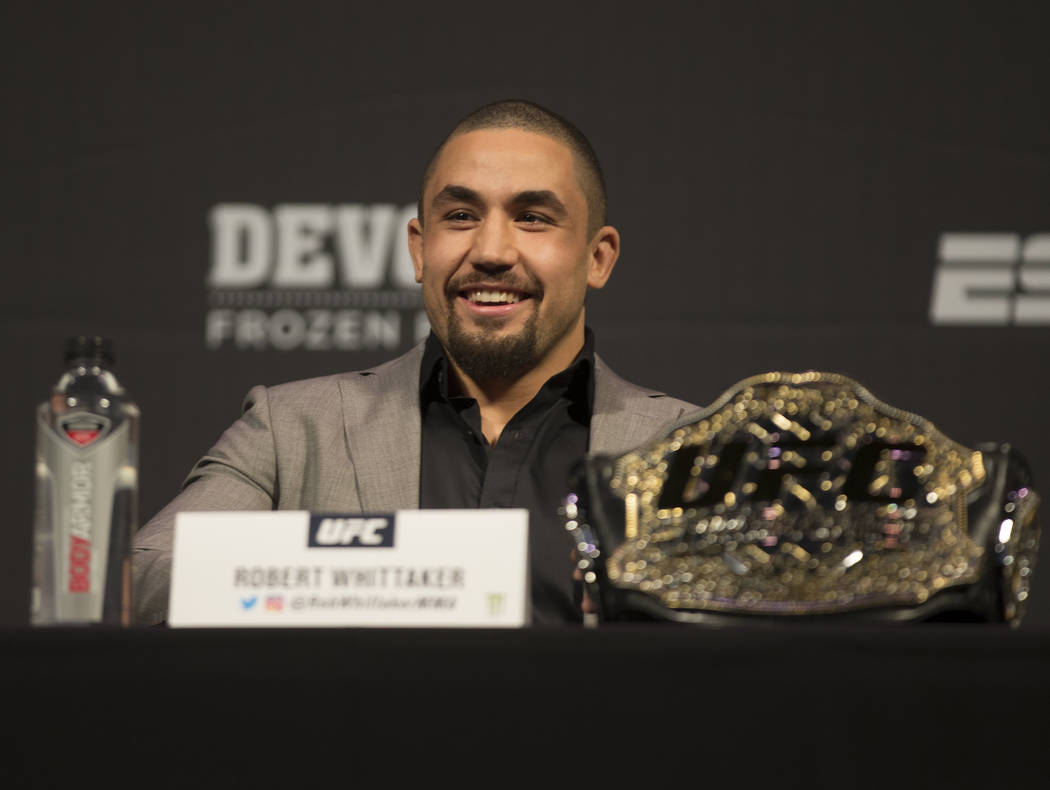 UFC middleweight champion Robert Whittaker addresses the media during a press conference on Fri ...