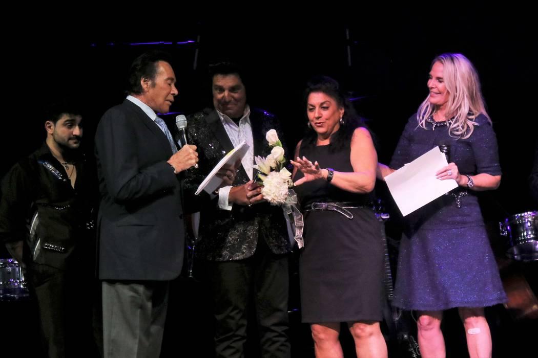 Wayne Newton help Vinny and Carol Adinolfi renew their vows with Kathleen Newton at far right. ...
