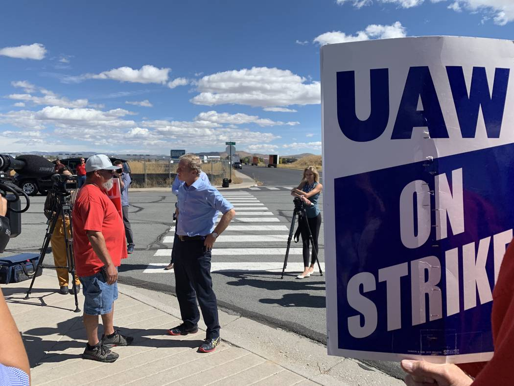 Democratic presidential candidate Tom Steyer speaks to striking auto workers outside a GM parts ...