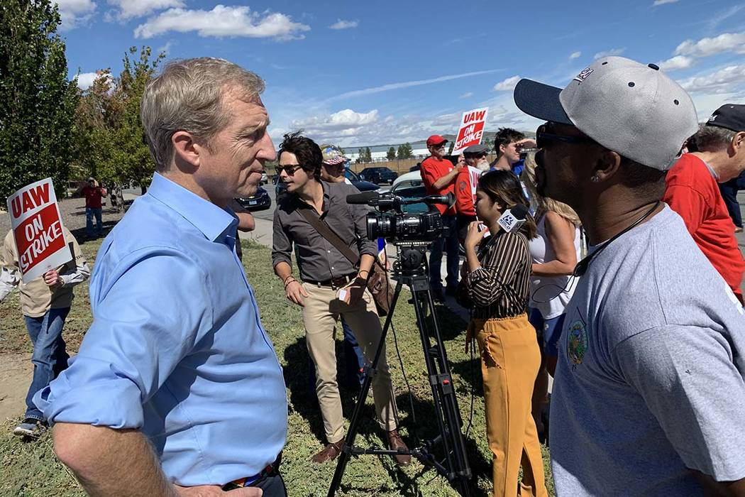 Democratic presidential candidate Tom Steyer speaks to Lance Pringle, president of UAW Local 21 ...