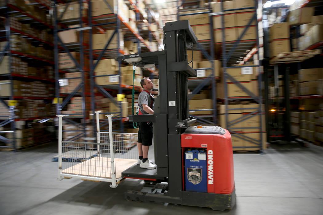 Cherry picker Christopher Giordani works in the new CarParts.com distribution facility in Las V ...