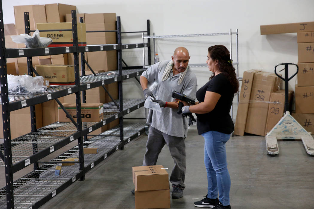 Expediter Jesus Rodriguez and small packer Alma Villa work in the new CarParts.com distribution ...