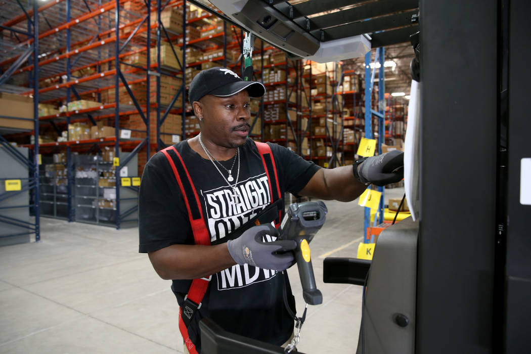 Cherry Picker Donald Marshall fills an order at the new CarParts.com distribution facility in L ...