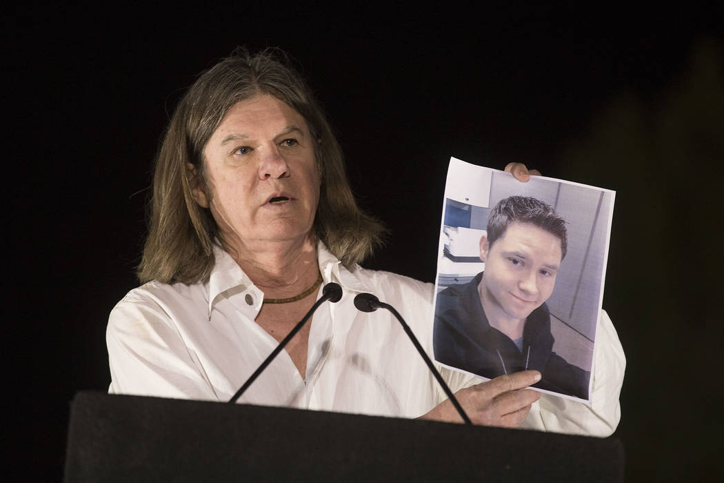 Las Vegas City Attorney Brad Jerbic holds up a sign of city employee and shooting victim Camero ...