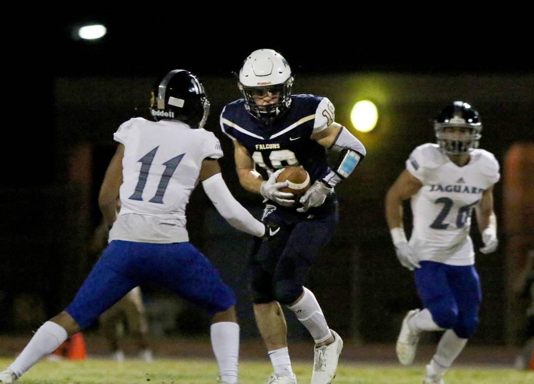 Desert Pines High's wide receiver Jett Solomon (11) defends Foothill High's wide receiver Thoma ...