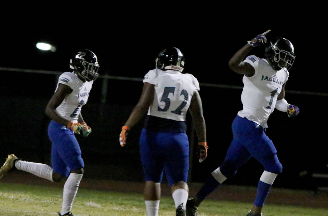 Desert Pines High's wide receiver Darnell Washington (1) celebrates his touchdown with his team ...