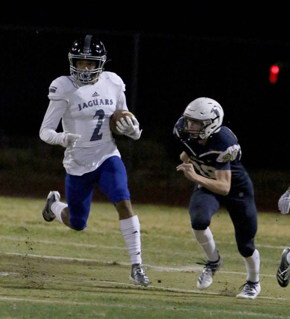 Desert Pines High's wide receiver Deandre Moore (2) returns a punt and goes for a touchdown as ...