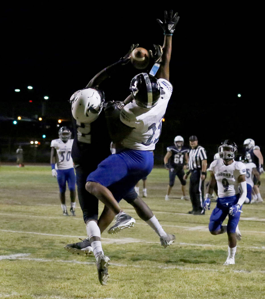Desert Pines High's cornerback Andrew Williams (23) blocks the ball from Foothill High's wide r ...