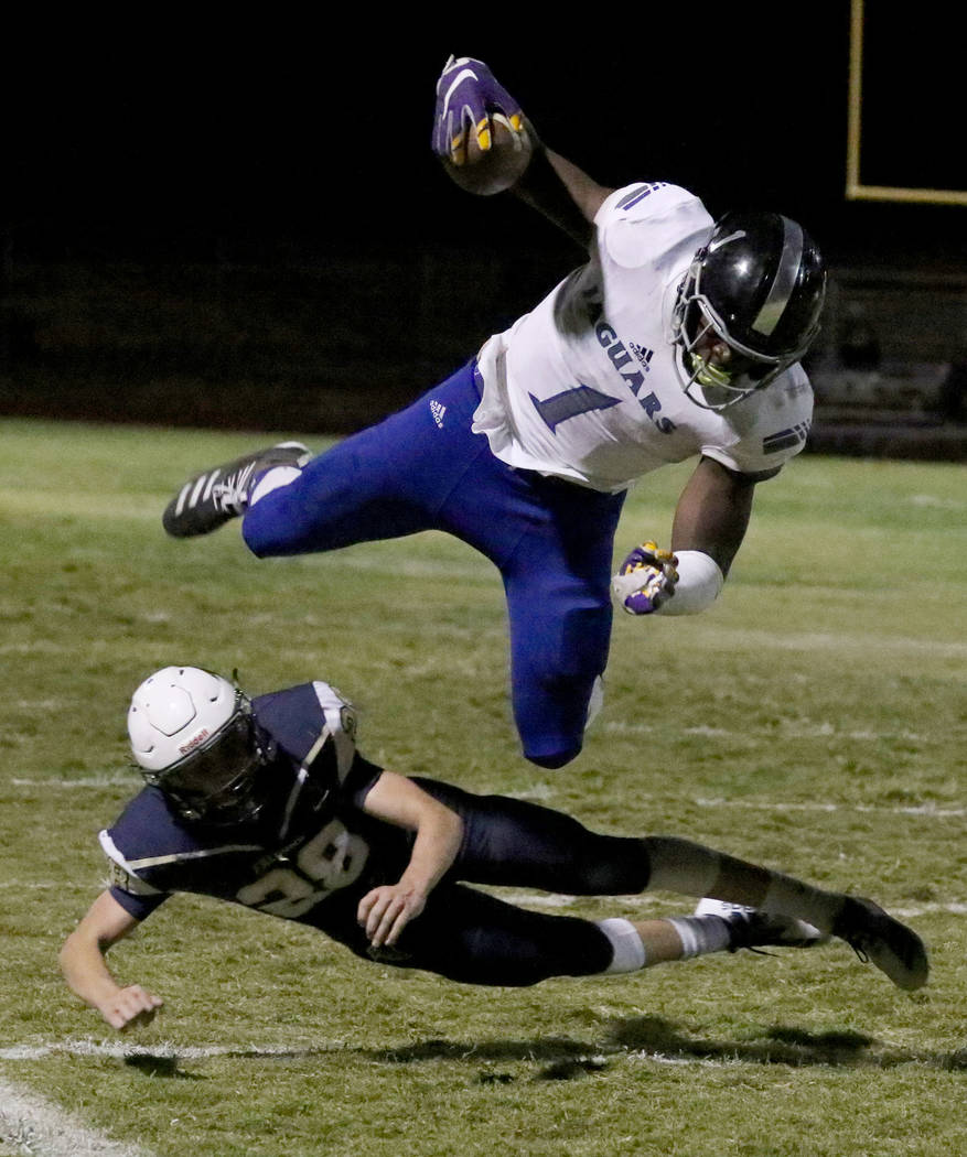 Desert Pines High's wide receiver Darnell Washington (1) avoids a tackle from Foothill High's&# ...