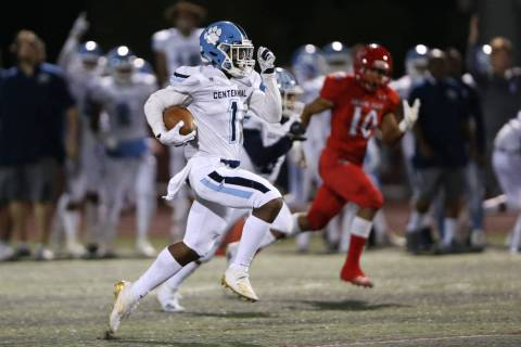 Centennial's Jordan Smith (1) runs the ball for a touchdown against Arbor View during the first ...