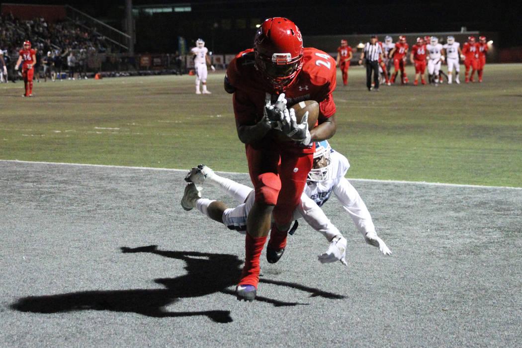 Arbor View's Daniel Mitchell (24) makes a catch for a touchdown against Centennial's Tyrone McC ...