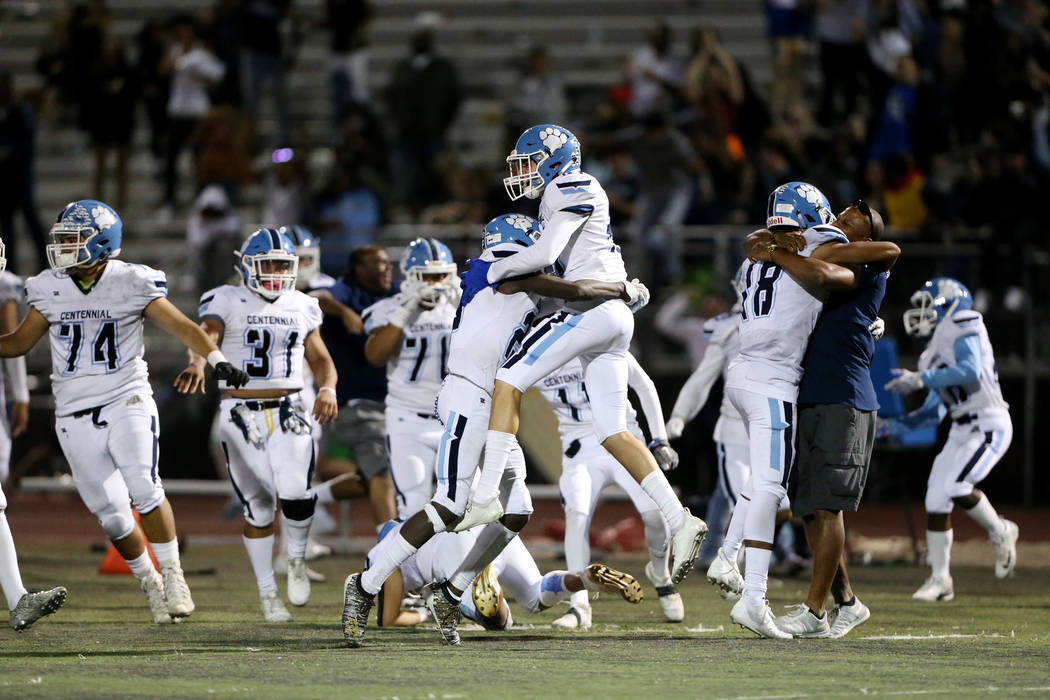 Centennial celebrates their 17-14 win against Arbor View in the football game at Arbor View Hig ...