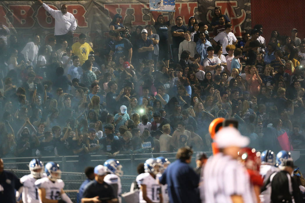 Centennial students after releasing a blue smoke during a football game against Arbor View at A ...