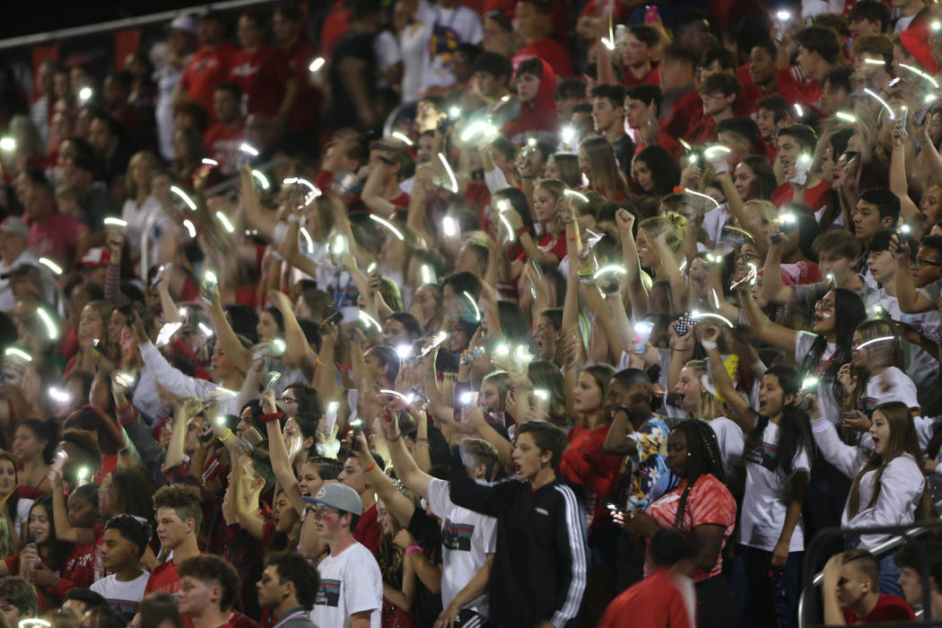 Arbor View students flash their lights during a football game against Centennial at Arbor View ...