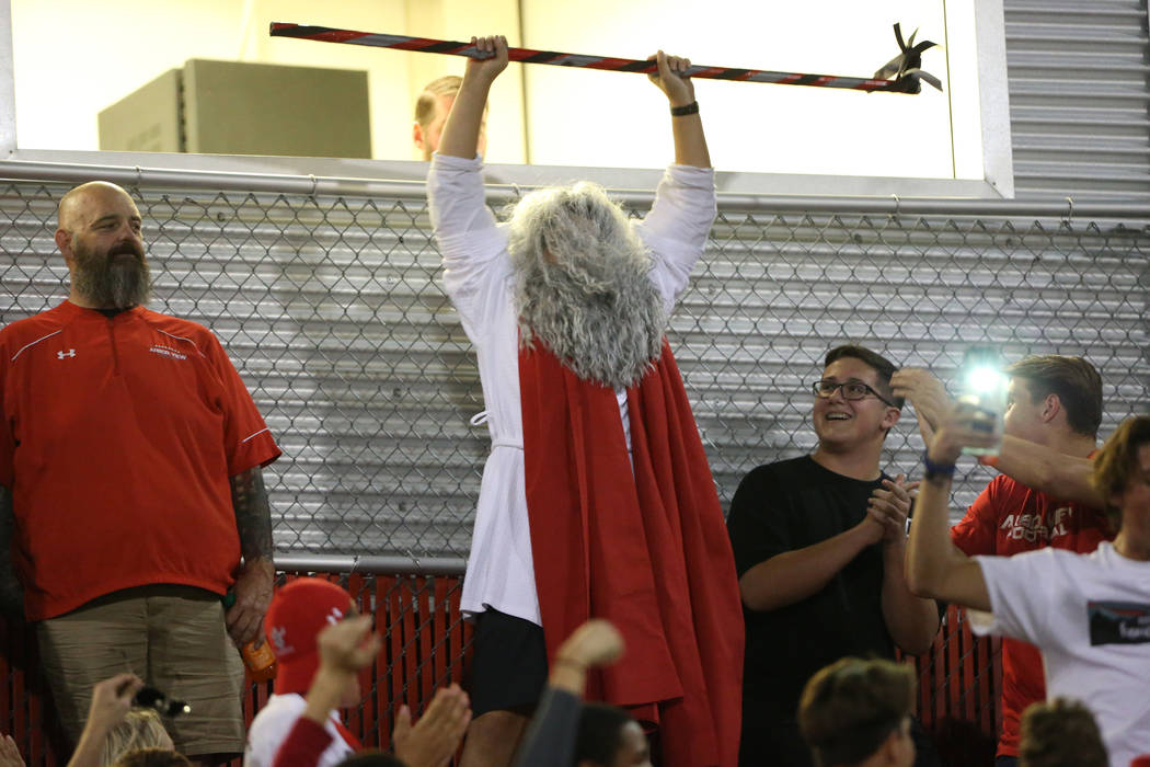 """""""Moses"""" makes his entrance to the football game between Arbor View against Centennial ..."""