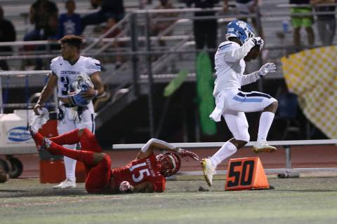 Centennial's Jordan Smith (1) runs the ball after a catch against Arbor View's Anthony Jones (1 ...