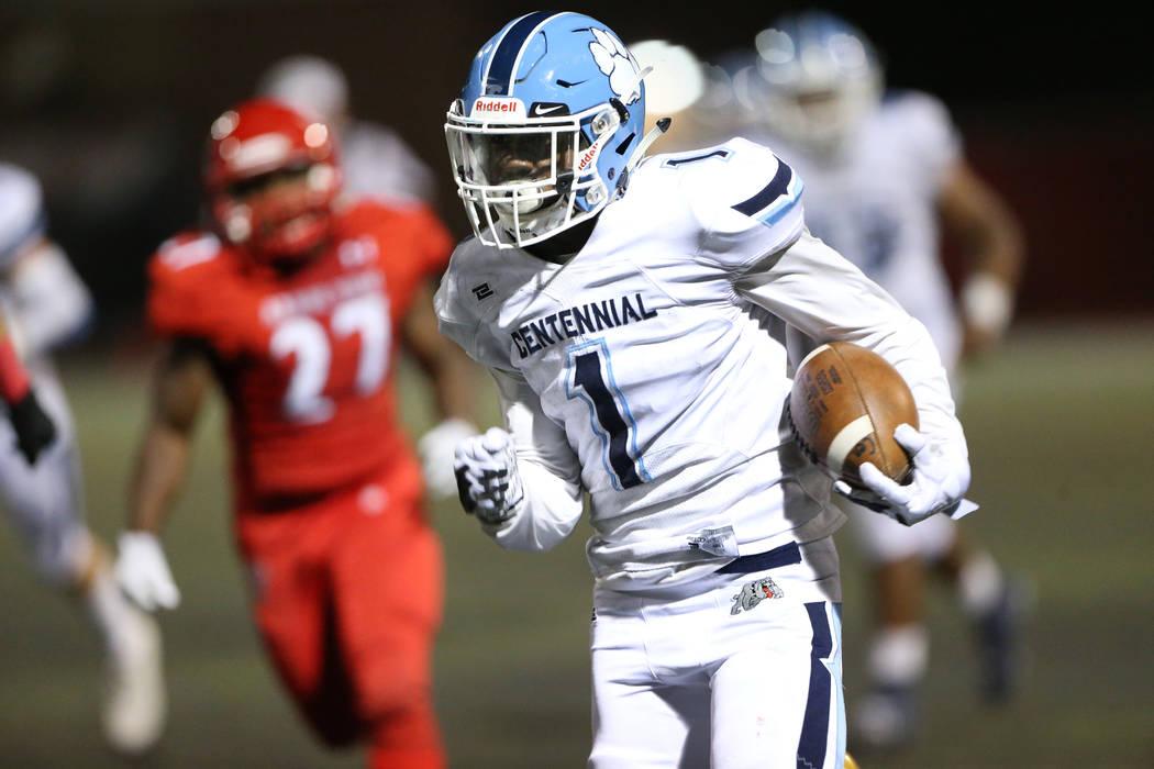 Centennial's Jordan Smith (1) runs for a touchdown against Arbor View during the fourth quarter ...