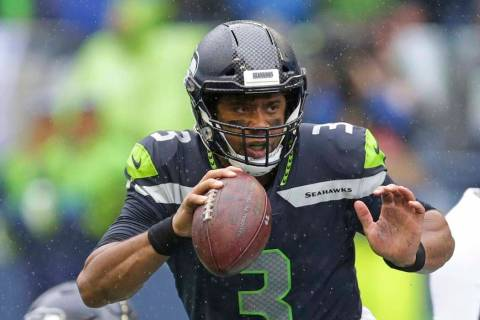 Seattle Seahawks quarterback Russell Wilson looks to pass against the New Orleans Saints during ...
