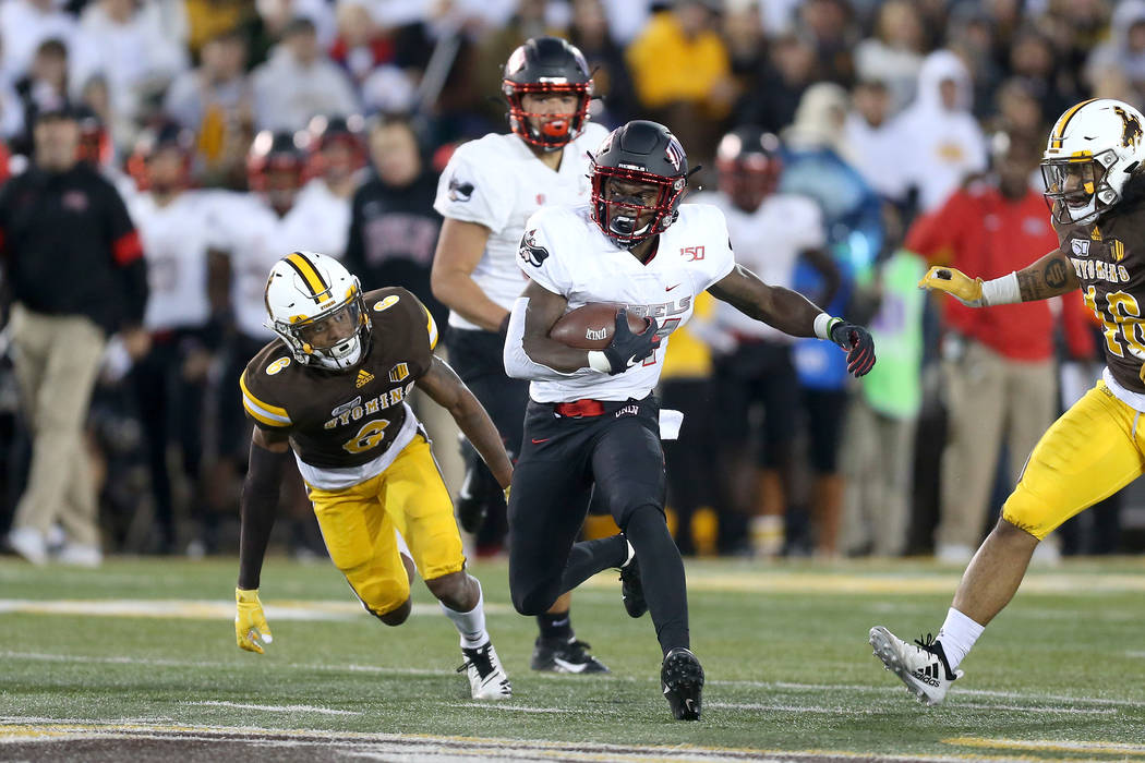 UNLV running back Darren Williams cuts upfield during the Mountain West game against the Univer ...