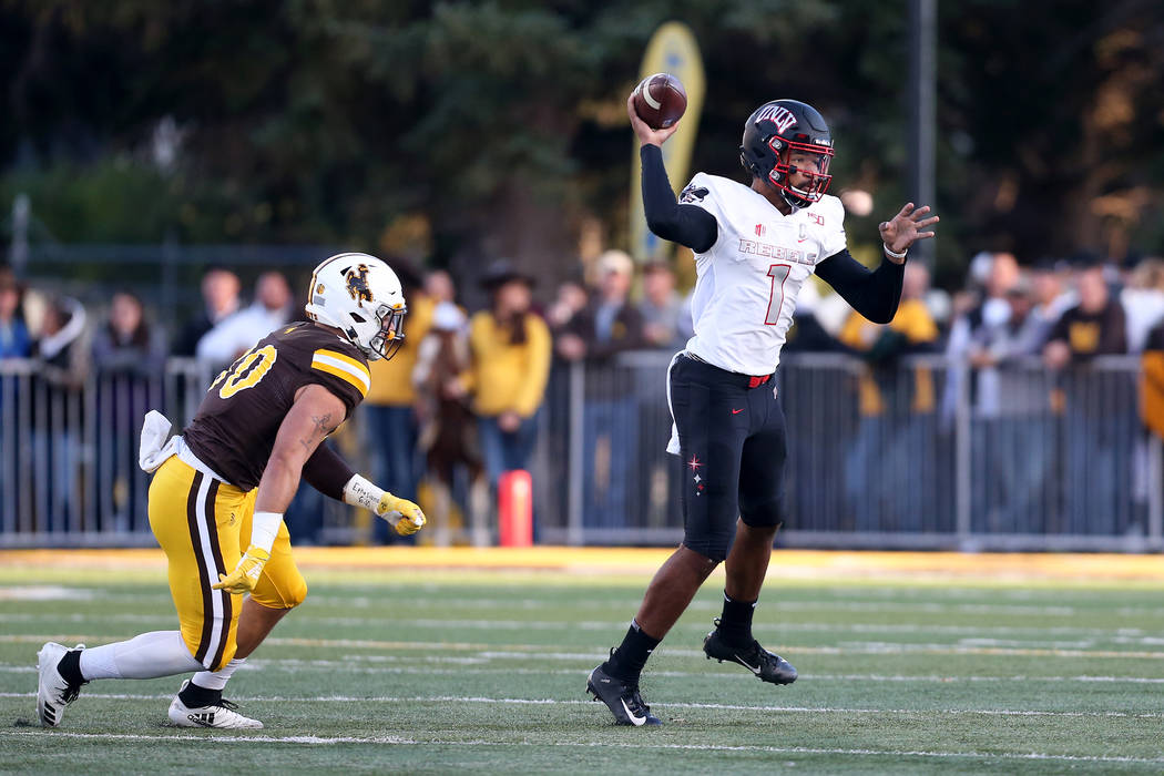 UNLV quarterback Armani Rogers throws a pass during the Mountain West game against the Universi ...
