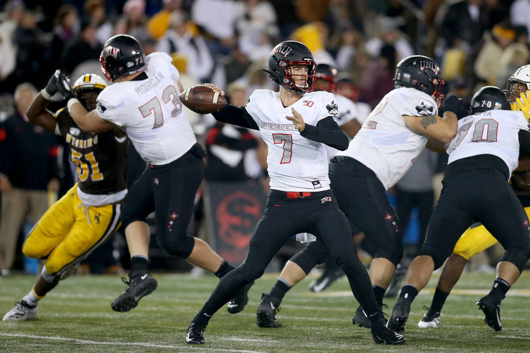 UNLV quarterback Kenyon Oblad throws a pass during the Mountain West game against the Universit ...