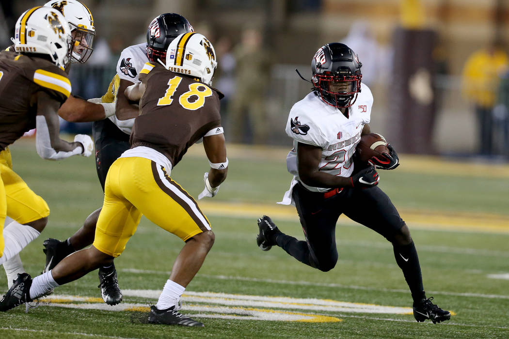 UNLV running back Courtney Reese tries to turn the corner while running during the Mountain Wes ...