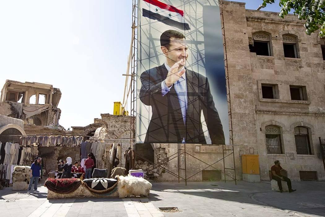 In this photo taken on Friday, Sept. 27, 2019, A huge portrait of Syrian President Bashar Assad ...