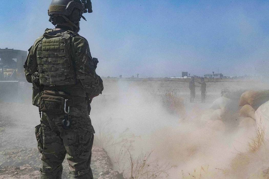 In this Sept. 21, 2019, photo, released by the U.S. Army, a U.S. soldier oversees members of th ...