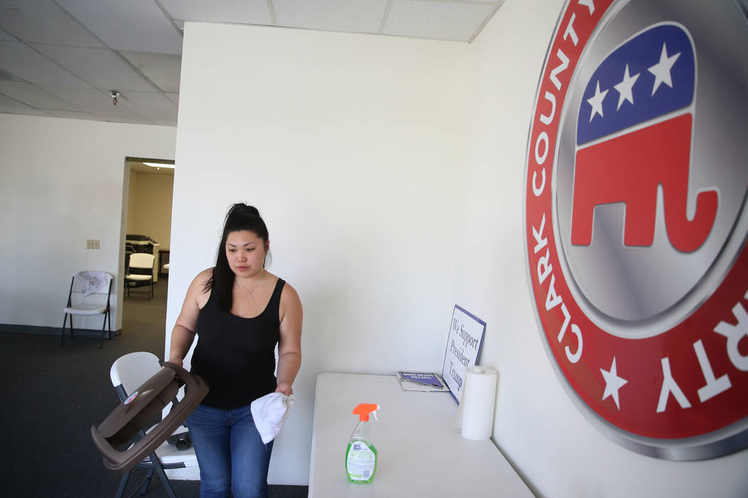 Tiffany Fung, political director of the Clark County Republican Party, cleans up after a break- ...